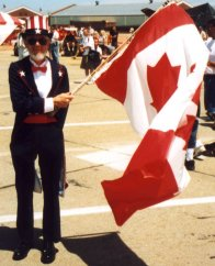 Uncle Sam holding a Canadian flag
